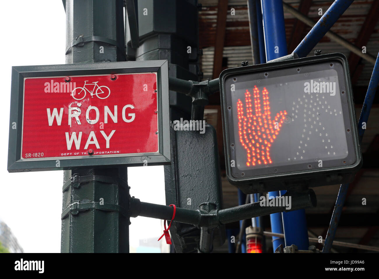 Red don't walk street sign and wrong way sign, New York City, New York, USA - Stock Image