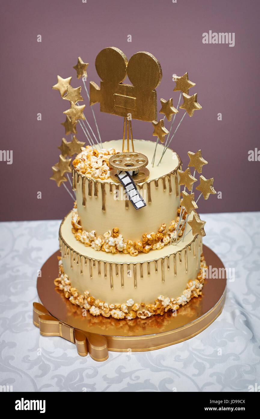 White Wedding Cake style of cinema on table Stock Photo: 145878458 ...