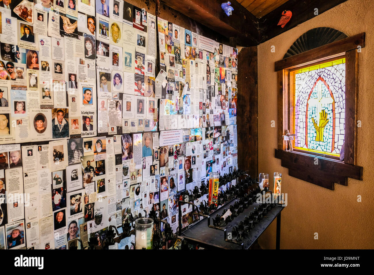 A shrine to pray for life and love, with family photos on the wall, in Chimayo, New Mexico, USA - Stock Image