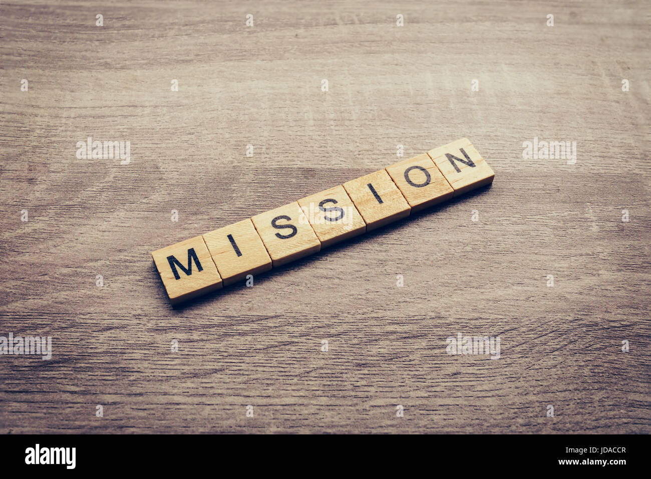 Mission word on wood table for business concept. - Stock Image