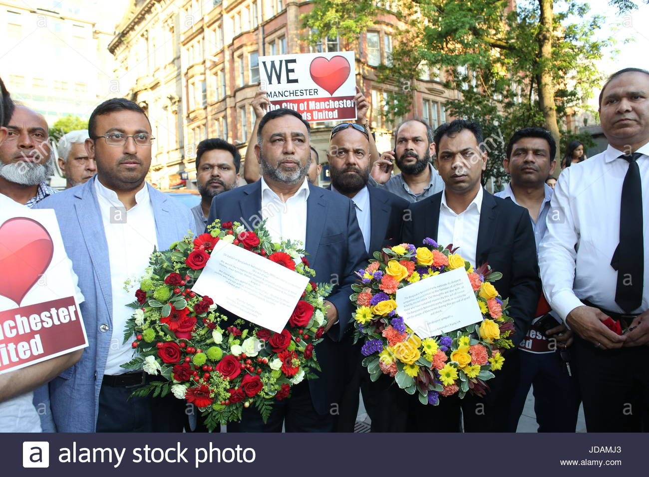Members of the Muslim community in Manchester arrive in St Ann's Square to lay wreaths in honour of the victims - Stock Image
