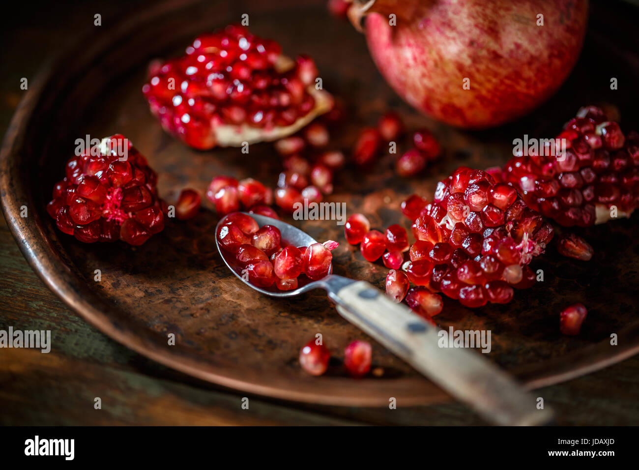 Fresh peeled pomegranates with ruby red beans - Stock Image