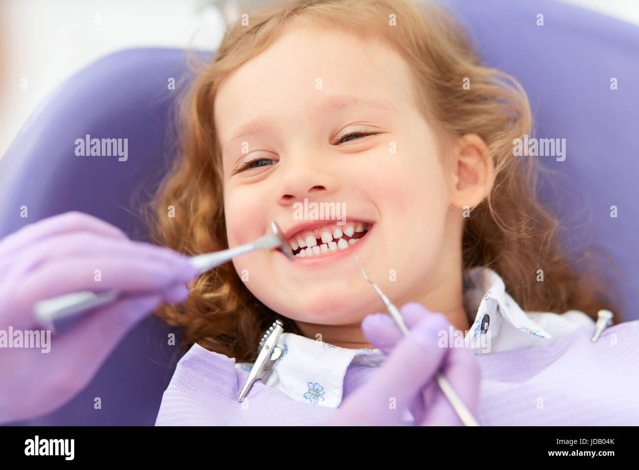 Smiling girl at dentist - Stock Image