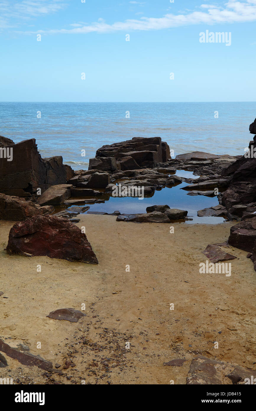 View onto rocks and sea at the coast in Torres, Rio Grande do Sul, Brazil - Stock Image