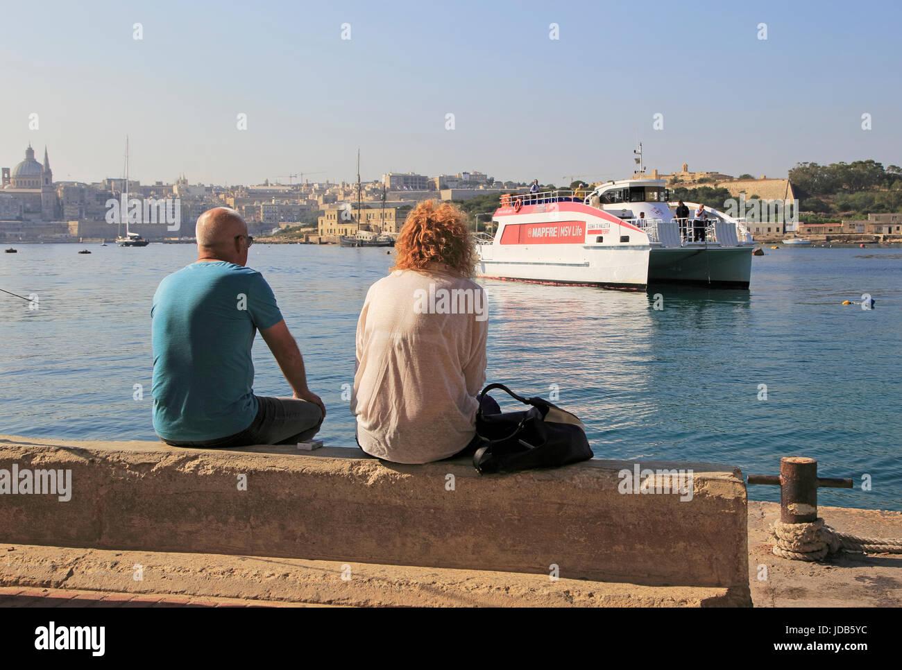 Mapfre catamaran ferry arriving at Sliema from Valletta, Malta - Stock Image