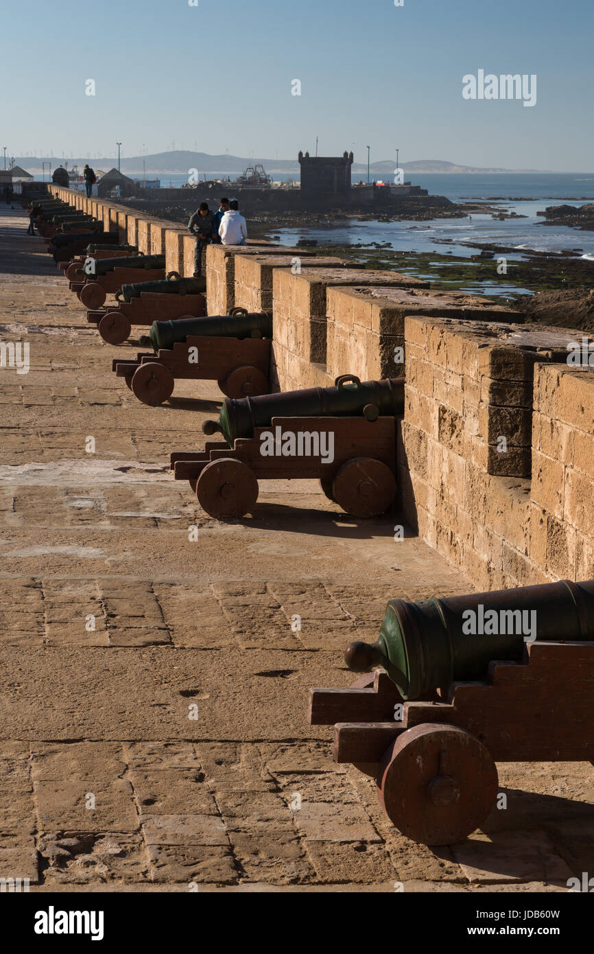 A line of old cannons guard the walls of the town of Essaouira in Morocco Stock Photo