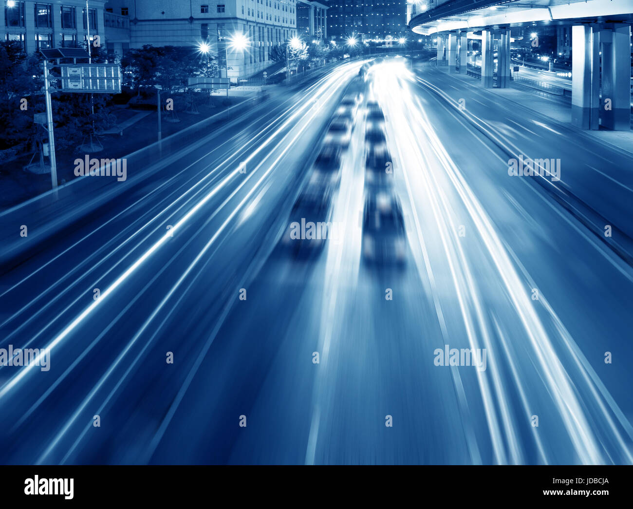 Highways and overpasses at night - Stock Image