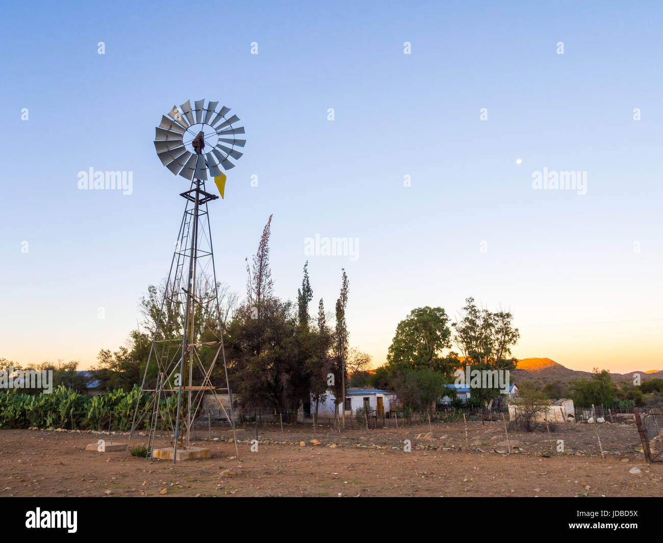 Windmill next to a farm on the road to Solitaire, Khomas Highlands, Namibia. - Stock Image