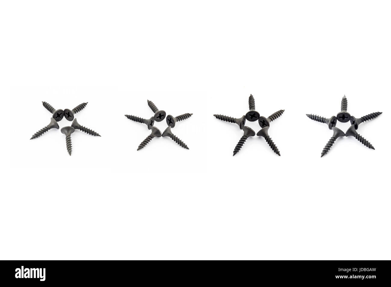 Five stars in a raw laid out with black Oxidized self-tapping screw isolated on white background - Stock Image