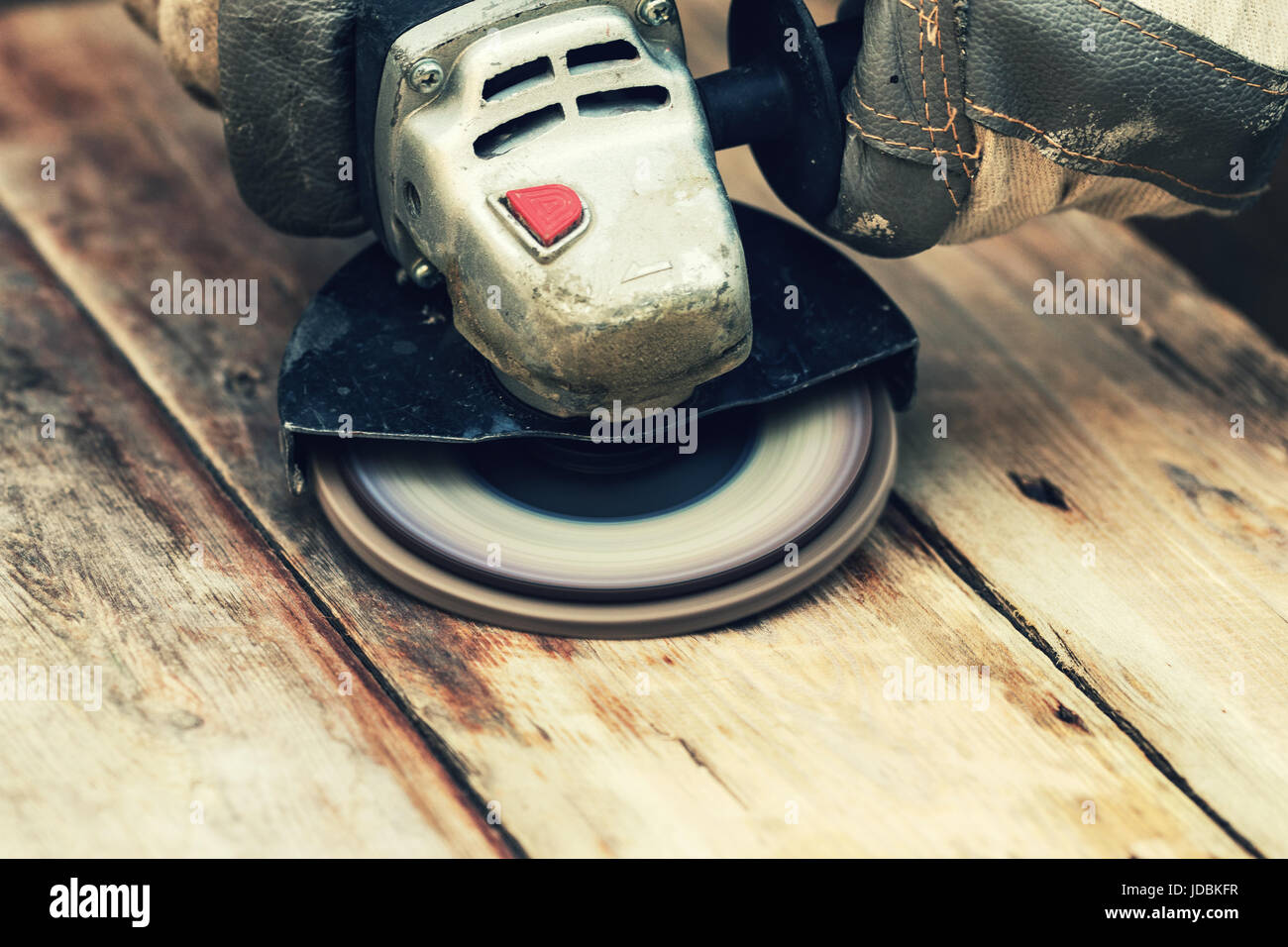 restore old wooden planks with angle grinder Stock Photo