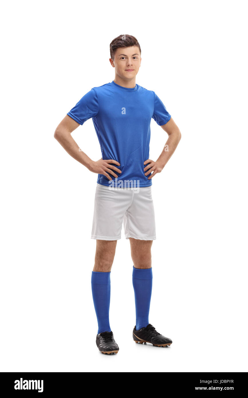 Full length portrait of a teenage soccer player isolated on white background - Stock Image