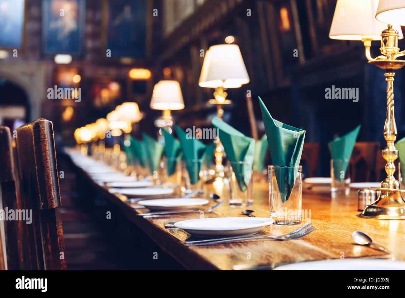Table set at The Great Hall of Christ Church, University of Oxford. The Hall was replicated at film studios as the - Stock Image