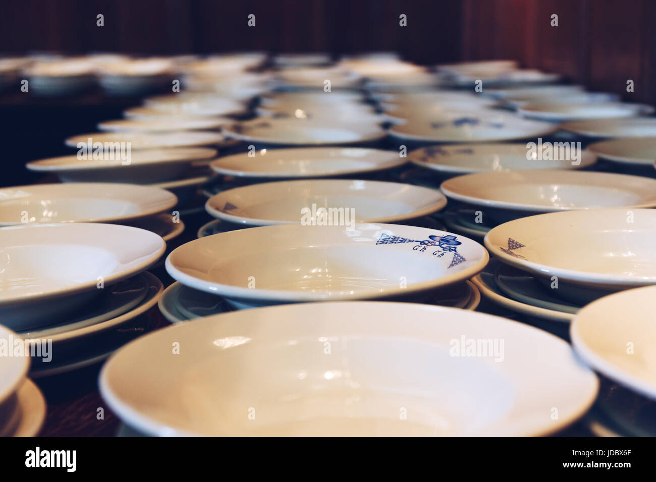 Plates lined up for dinner at The Great Hall of Christ Church College. The Hall was replicated at film studios as - Stock Image