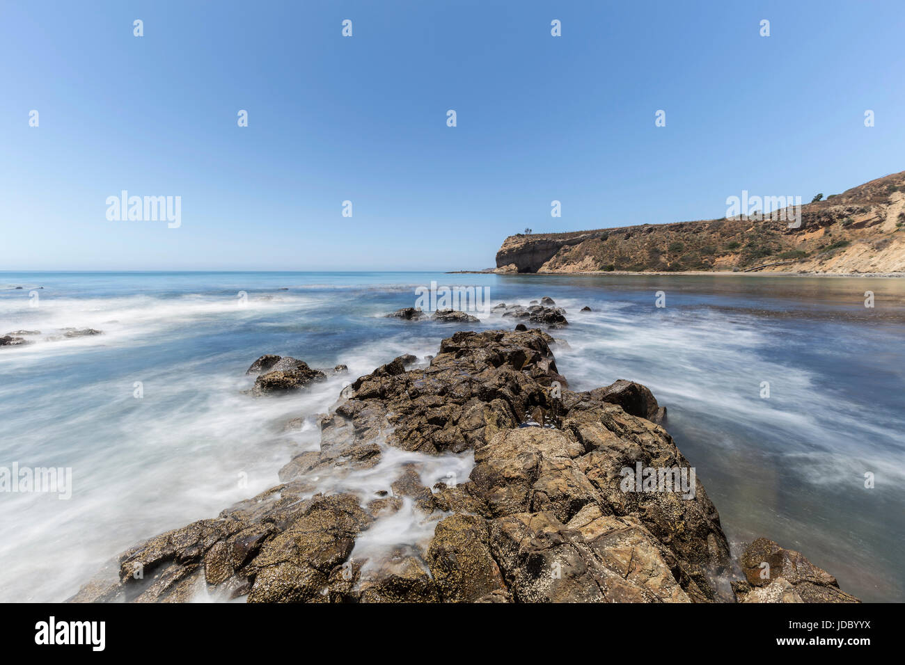 Pacific ocean motion blur water at Abalone Cove Shoreline Park in Southern California. - Stock Image