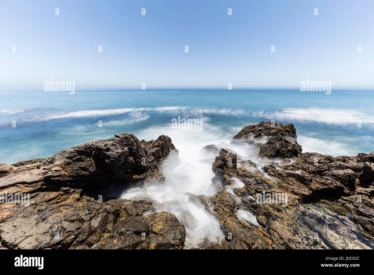 Tidal pool with motion blur water at Abalone Cove Shoreline Park in Southern California. - Stock Image