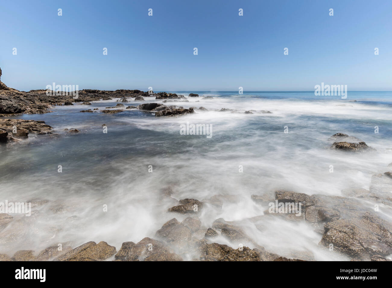 Pacific wave motion blur at Abalone Cove Shoreline Park in Southern California. - Stock Image