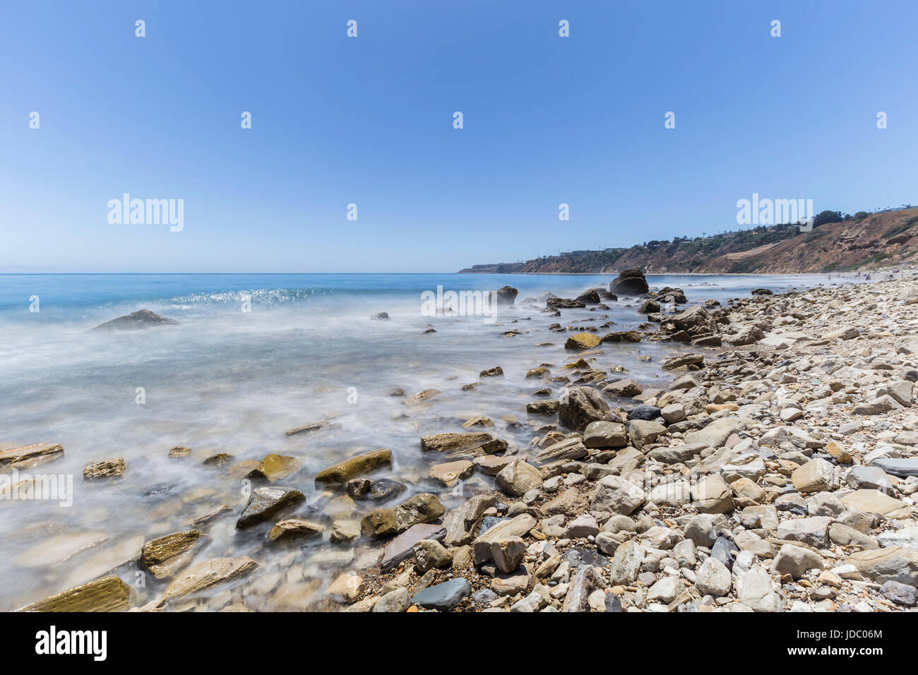 Ocean wave motion blur water at Abalone Cove Shoreline Park in Southern California. - Stock Image
