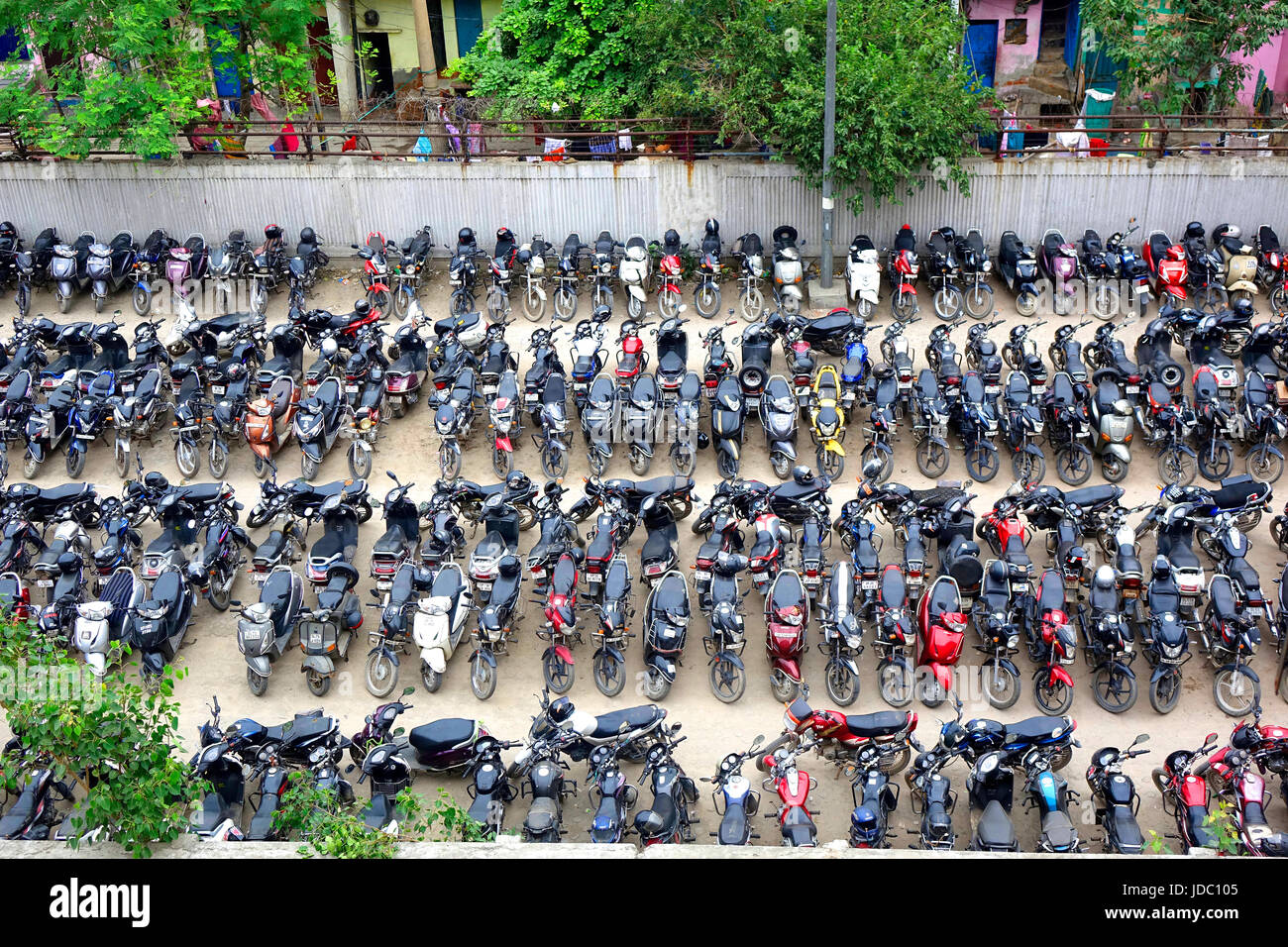 Top view of two wheeler vehicles parking in which motor bikes and  scooters arranged in proper way in rows Stock Photo