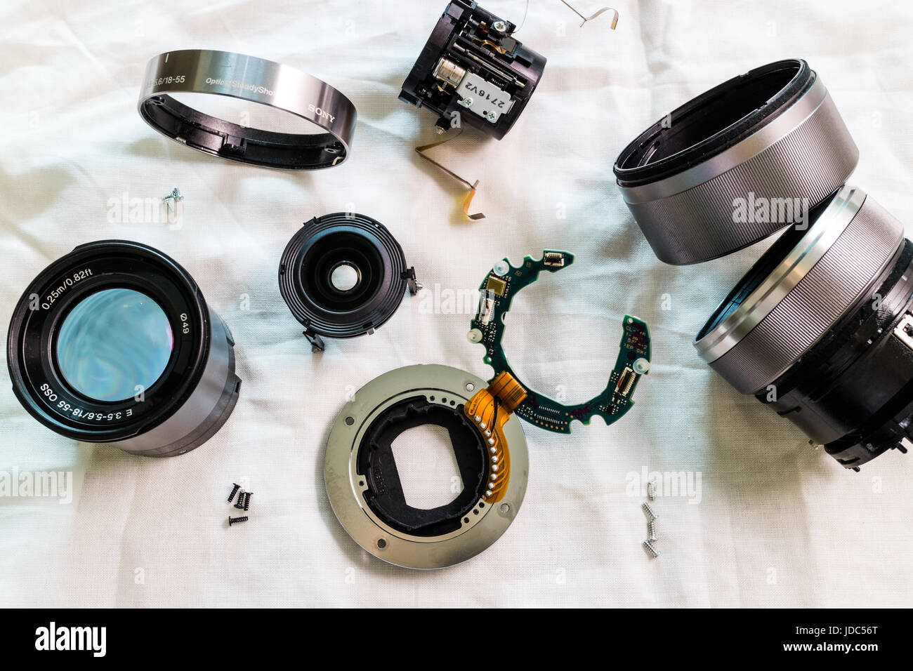 Disassembled lens parts, elements, components - Stock Image