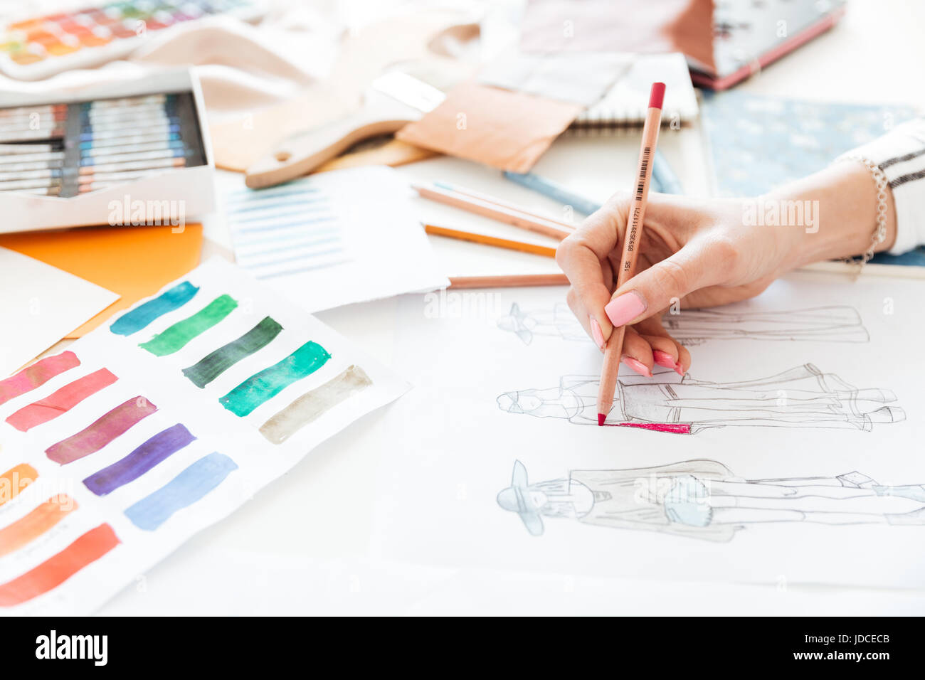Female Fashion Designer Working On Sketches With Paint In Studio Stock Photo Alamy