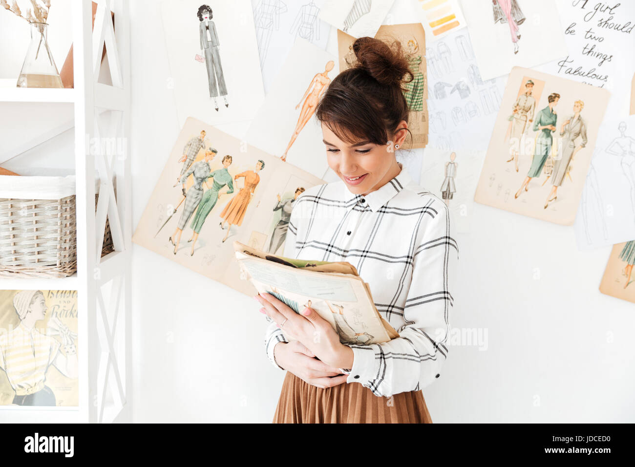 Young Woman Fashion Designer Looking At Sketchbook While Standing At Stock Photo Alamy