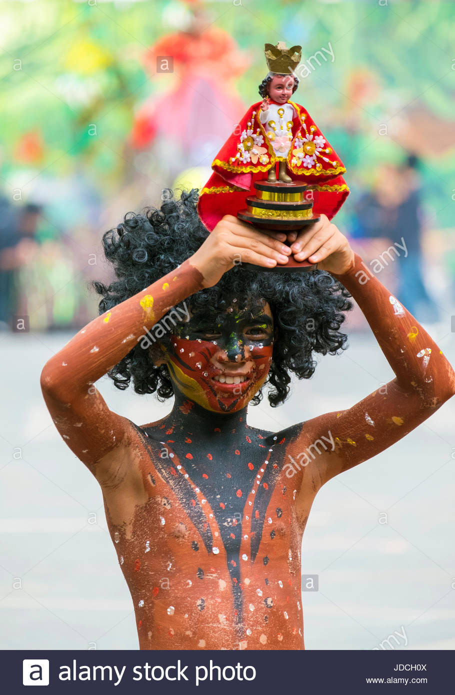 A young boy from Tribu Paghidaet holds an icon of Santo Niño during the 2015 Dinagyang Festival, Iloilo City, - Stock Image