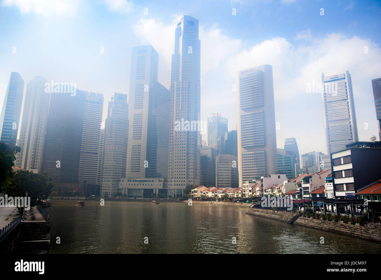 Sky-scrapers veiled by morning mist, Boat Quay, Singapore - Stock Image
