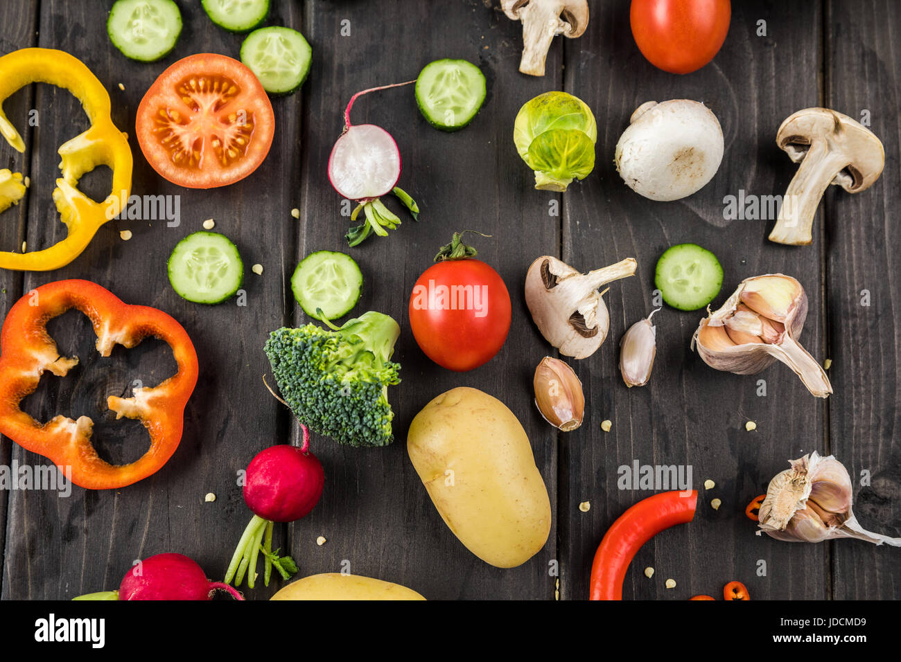 Close-up top view of fresh vegetables on rustic wooden table - Stock Image