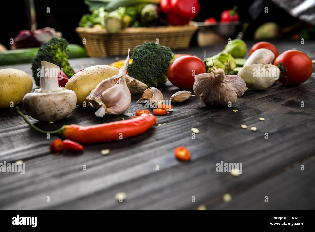 Close-up view of fresh seasonal vegetables on wooden table background - Stock Image