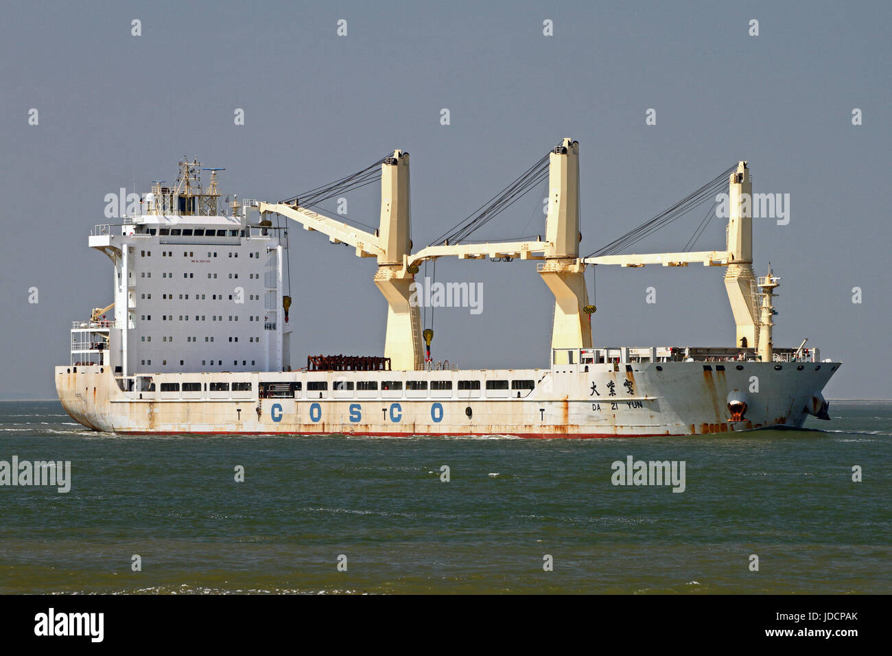 The general cargo ship Da Zi Yun on the schelde river passing Terneuzen on the way to the port of Antwerp - Stock Image
