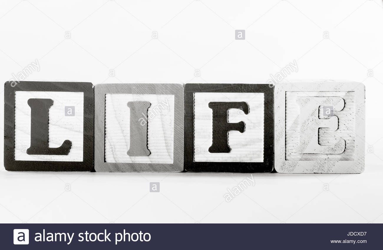 closeup of wooden letter blocks spelling out the word life - Stock Image