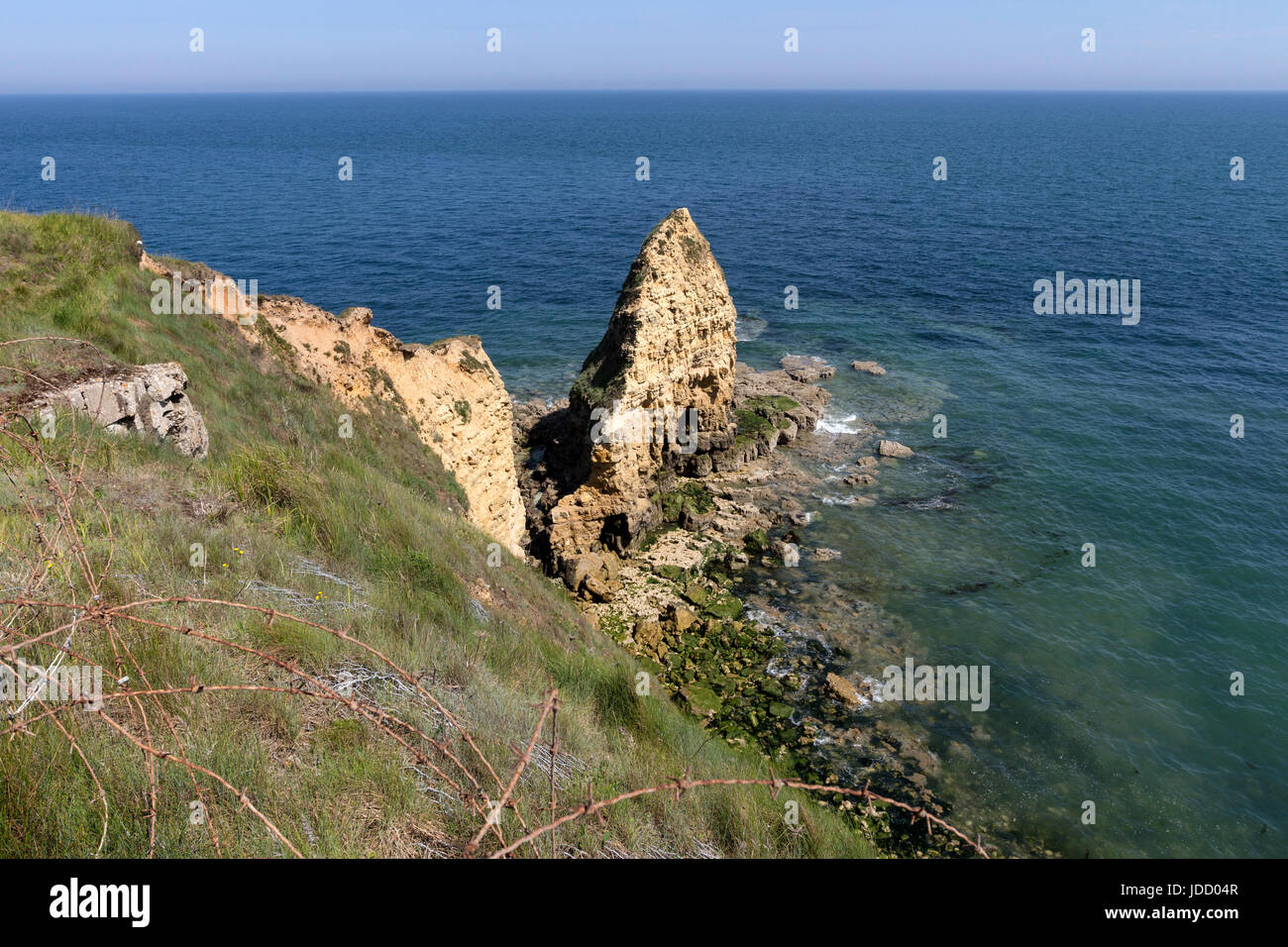 Barbed Wire and the Pointe Du Hoc, Normandy, France Stock Photo