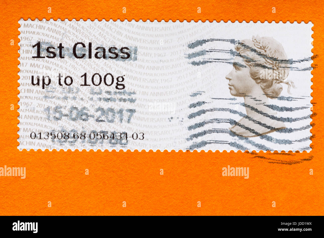 1st first class stamp up to 100g with Queen's head on orange envelope - Stock Image