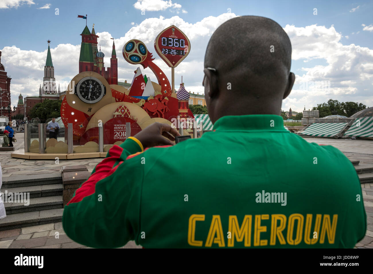 The fan of the national football team of Cameroon takes pictures of the Countdown clock before the World Cup in - Stock Image