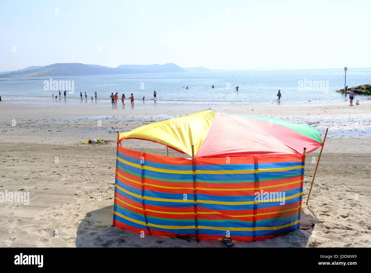 Lyme Regis , Dorset, UK. 20 June 2017.  This beach goer settled for another day of hot weather at Lyme Regis on - Stock Image