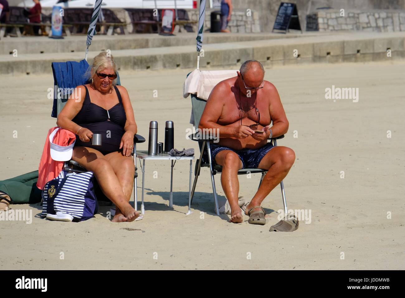 Lyme Regis , Dorset, UK. 20 June 2017.  Beach goers settle in for another day of hot weather at Lyme Regis on Dorset's - Stock Image