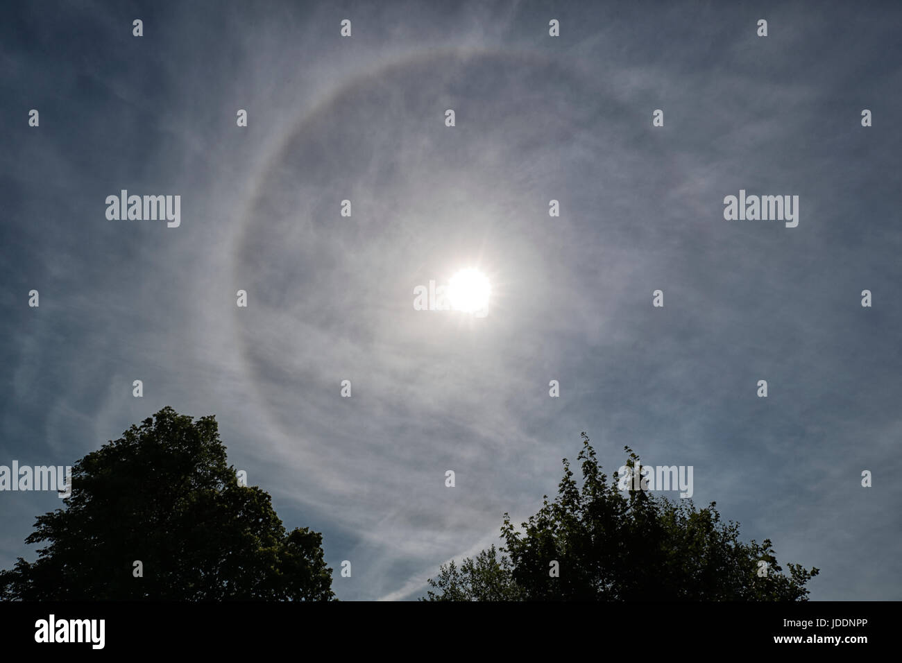 Otley, Leeds, UK. 19th June, 2017. Weather Sun Halo seen in the sky Monday 19-06-2017, 14.56 pm. Credit: Les Wagstaff/Alamy - Stock Image