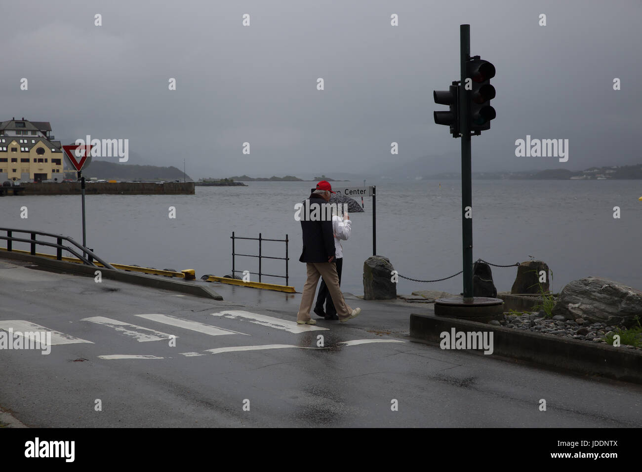 Weather, Norway, Grey and Dismal start in Alesund Credit: Keith Larby/Alamy Live News Stock Photo