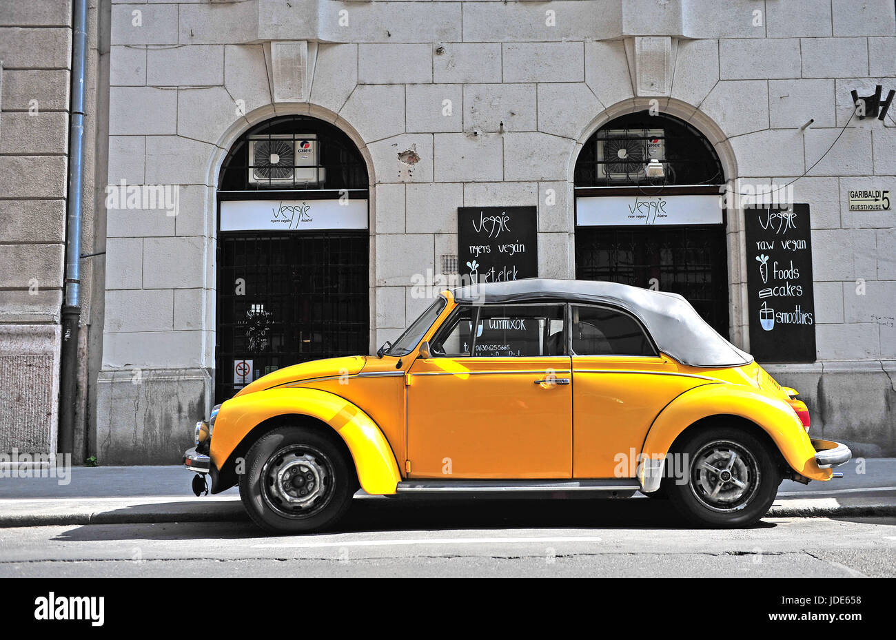 BUDAPEST, HUNGARY - MAY 29: Yellow retro Volkswagen beetle car in in street of Budapest on May 29, 2016. Stock Photo