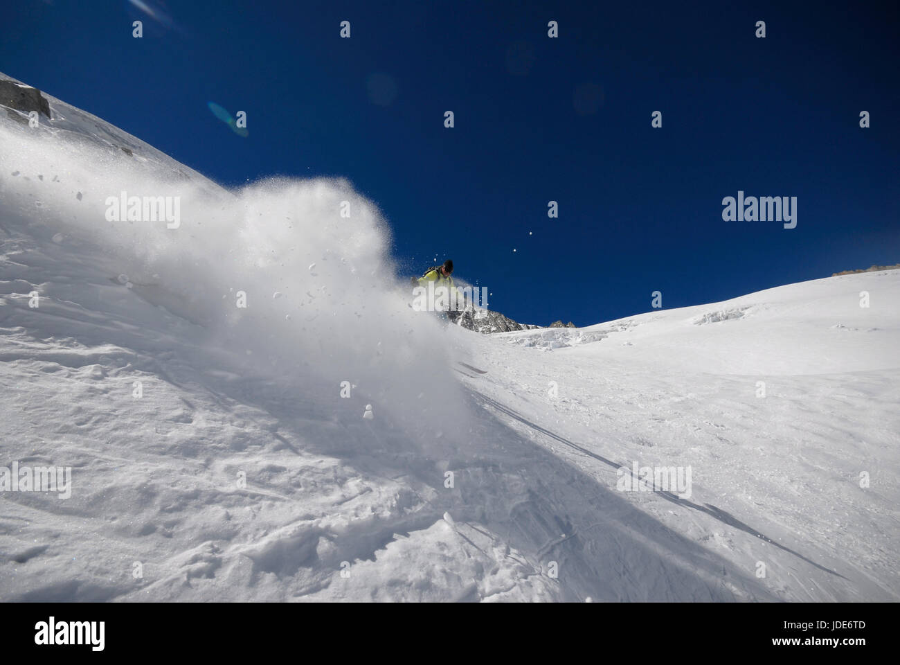 Lone skier off piste on the back of the Grand Monte descending to the Argenetiere glacier - Stock Image