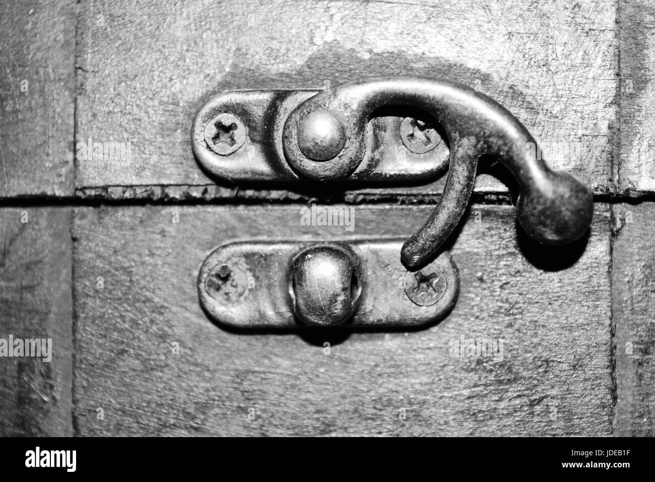 Brass closing hook of a secret casket box - Stock Image