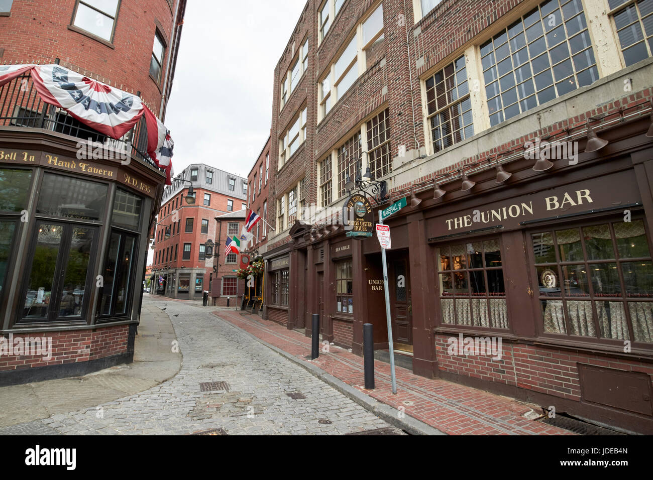 narrow cobbled marshall street between the bell in hand tavern and ye olde union oyster house original Boston USA - Stock Image