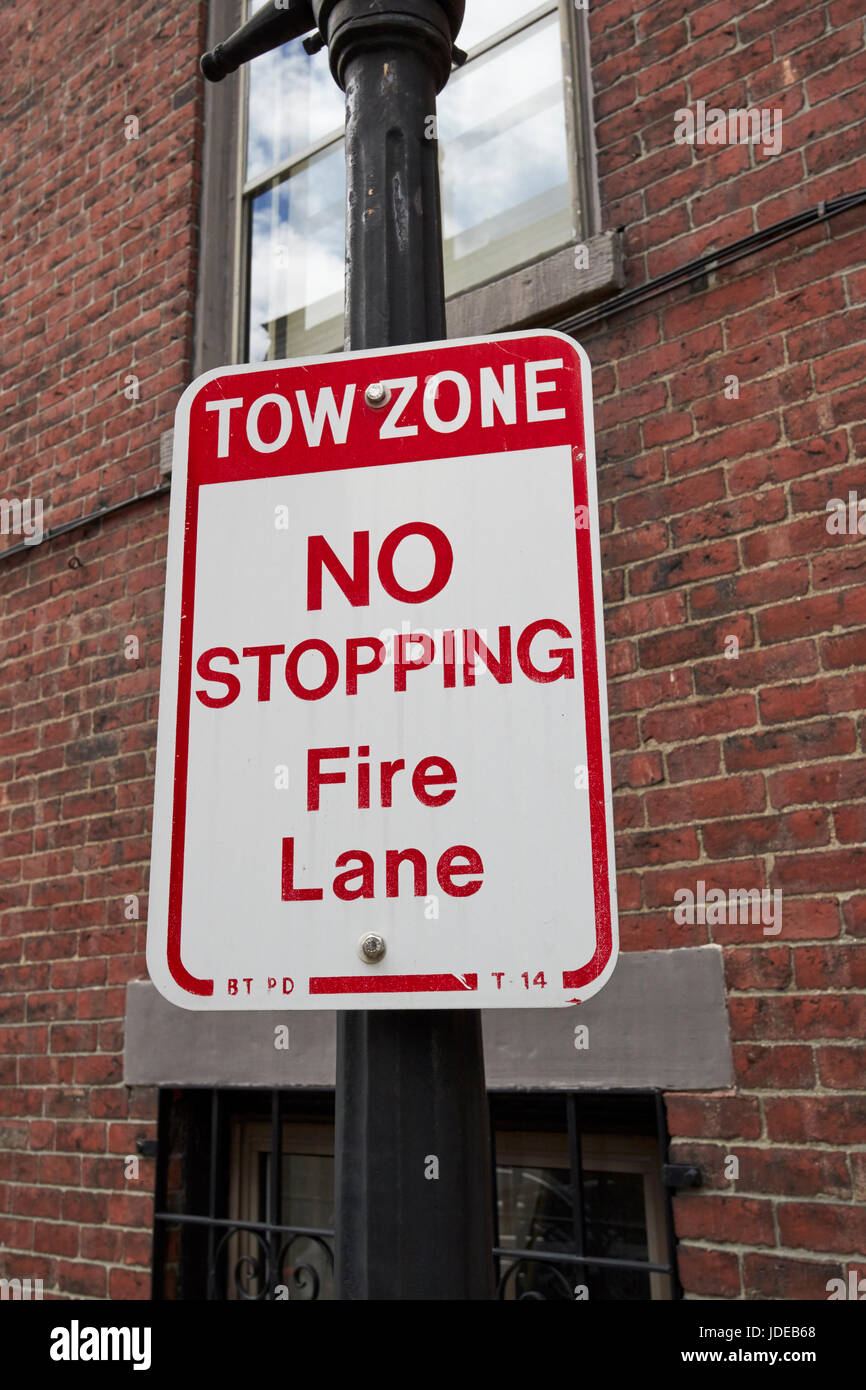 sign for tow zone no stopping fire lane in historic downtown Boston USA - Stock Image