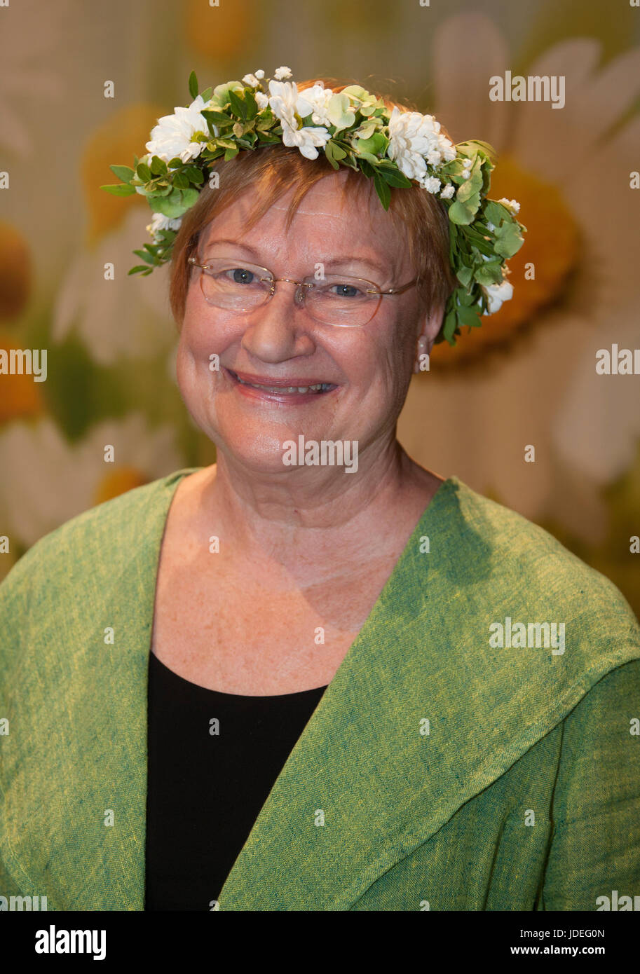 TARJA HALONEN former Finish president with flower ring on the head 2017 - Stock Image