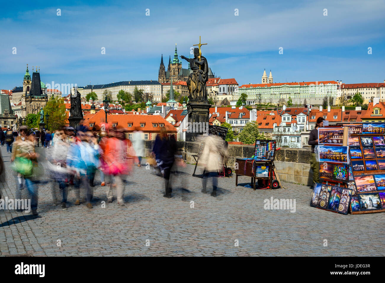 Crowds of tourists and stalls selling souvenirs on Charles Bridge, Prague, Bohemia, Czech Republic - Stock Image