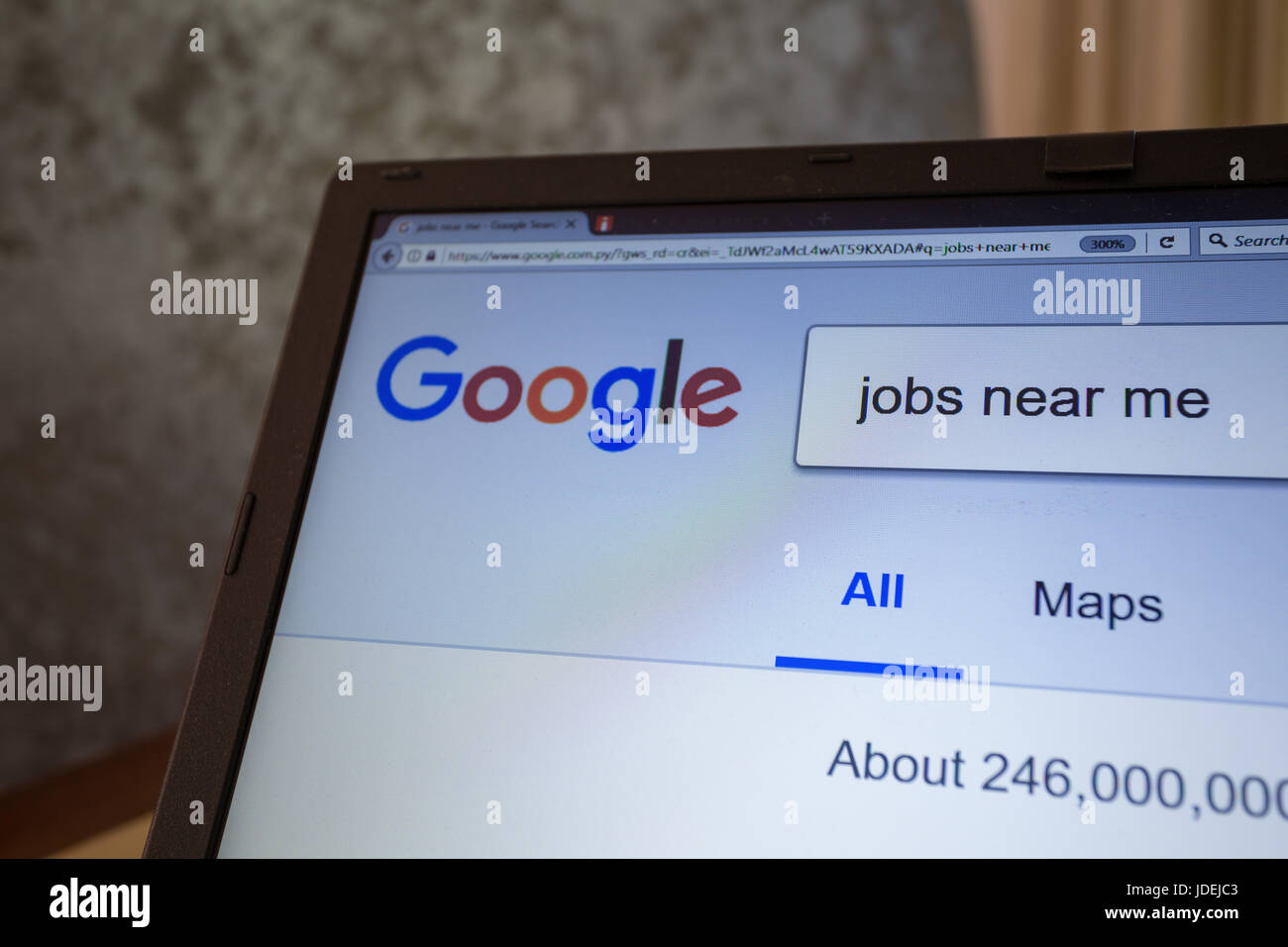 A Notebook Display Shows Google Search Engine For Jobs Near Me