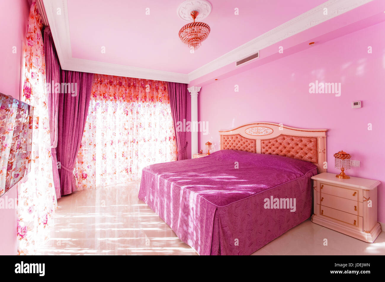 Luxurious bedroom with a bright pink color, with large ...