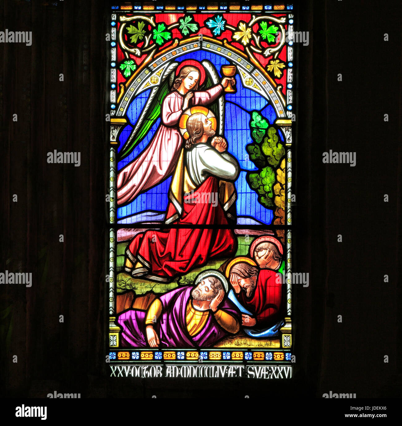 Story of Easter, Jesus prays in Garden of Gethsemane, by the Mount of Olives, while disciples sleep, stained glass - Stock Image