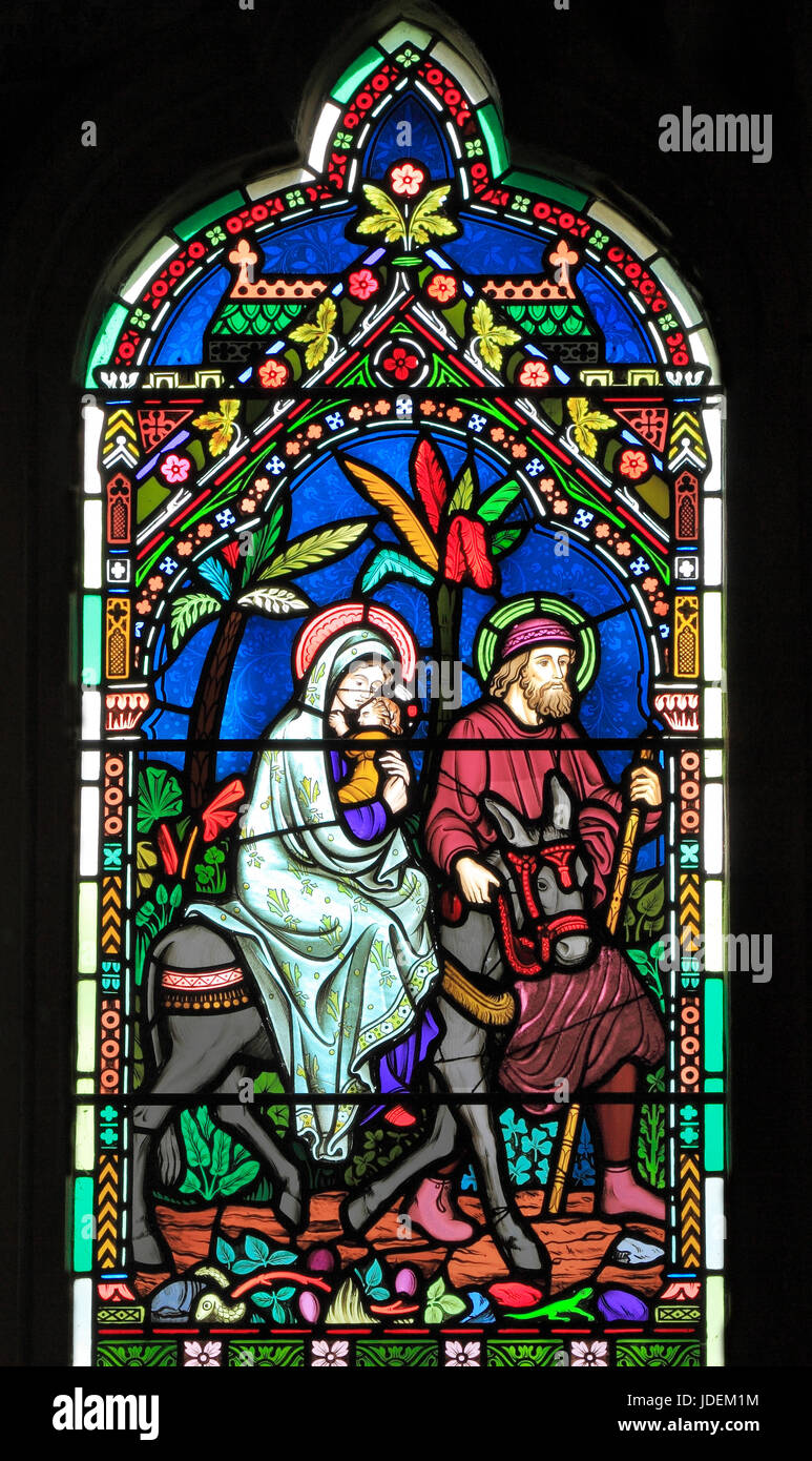 Flight to Egypt, Joseph, Mary, baby Jesus escape slaughter of new born males, stained glass window by Frederick - Stock Image