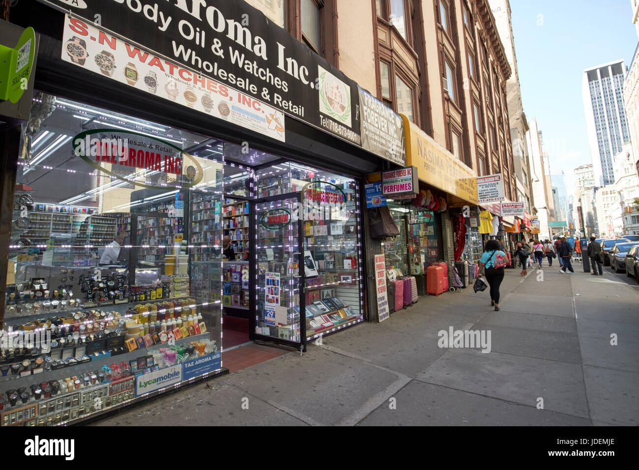 stores on broadway in new yorks perfume district New York City USA - Stock Image